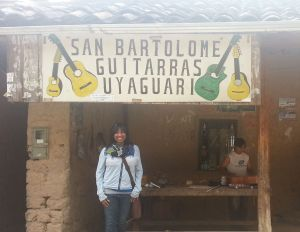 In front of the home and workshop of the Uyaguari family, makers of guitars - San Bartolome, Ecuador