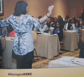 Photo of Dr. Renetta Tull addressing students, reprinted from the NSBE Magazine, Convention 2015, p. 45.